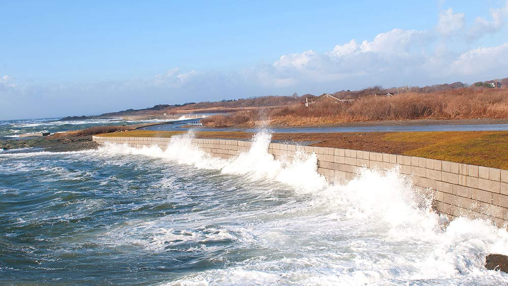 A wave breaking against a seawall